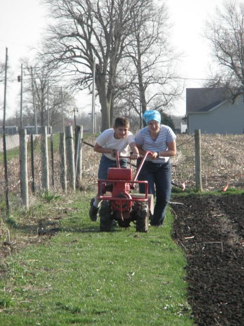 Teamwork on the farm and tiller.