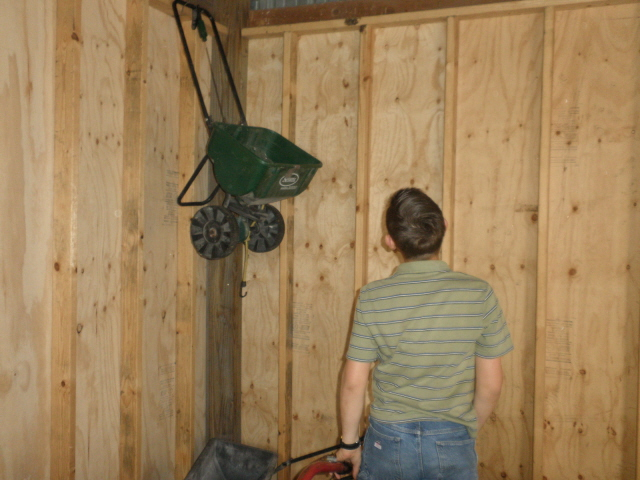 Tim searching for Easter eggs in the barn.